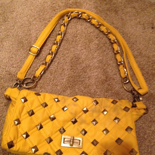 Yellow stud purse large comfy  is being swapped online for free