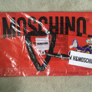 H&M Mochino Donald Duck dj Mesh t shirt size M is being swapped online for free