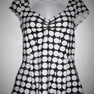 Black & White Polka Dot Peplum Top - Size XS is being swapped online for free