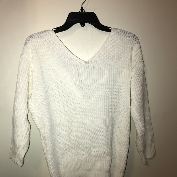 Women's white knit crossed sweater size small is being swapped online for free