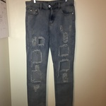 Women's destroyed light wash denim jeans size small is being swapped online for free