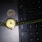 JQ Quartz Brass Wrap Around Watch Womens with Buckle Hunter Green Adjustable 24 inches long is being swapped online for free