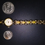Gold Plated Citizen Elegance Womans Watch Yellowis stones in links Iredescent Face is being swapped online for free