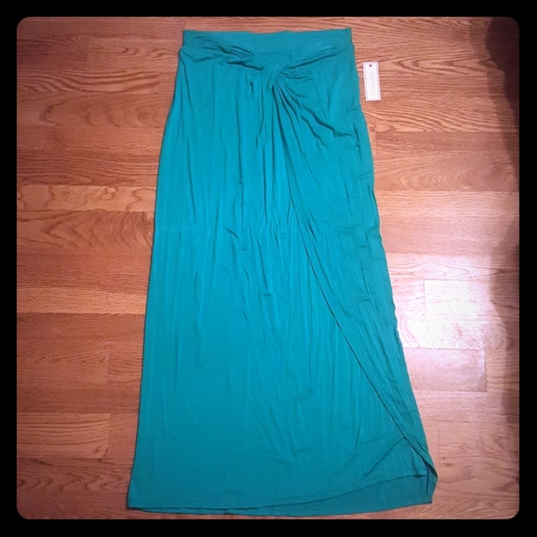 Bisou Bisou Teal Maxi Skirt  is being swapped online for free
