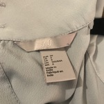 H&M Light Blue Blouse is being swapped online for free