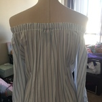 White and Pin Blue Striped Flowy Off the Shoulder Top is being swapped online for free