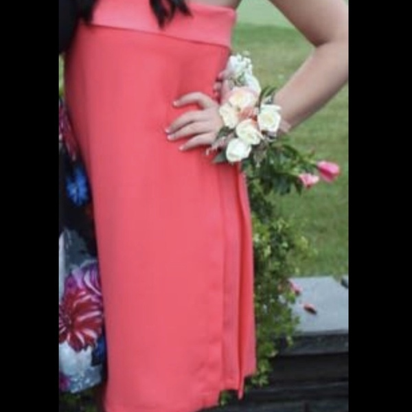 Coral size 4 strapless dress is being swapped online for free