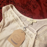NWT cream cold shoulder medium blouse is being swapped online for free