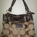 Beautiful COACH Purse !! is being swapped online for free