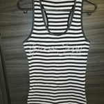 Women's GUESS Stripped T-Shirt  is being swapped online for free
