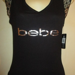 BEBE Awesome, Brand New with tags T-shirt with lace back ! is being swapped online for free