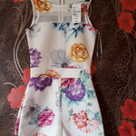 Lovely size 8 never worn with tags playsuit is being swapped online for free