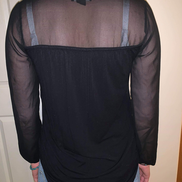 Chic black blouse  is being swapped online for free