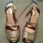 Gold sparkley Guess heels is being swapped online for free