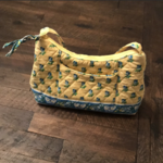 yellow Vera Bradley mini purse  is being swapped online for free