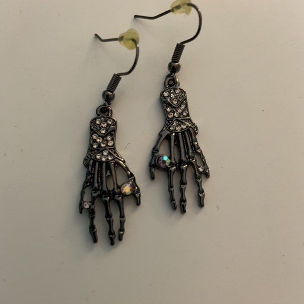 Silver Skeleton Hand Earrings is being swapped online for free