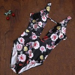 NEW Deep V Plunging Floral Swim Suit Sz S/M is being swapped online for free
