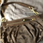 Coach purse brown is being swapped online for free