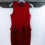 Short, red sleeveless fitted waist ruffle dress is being swapped online for free