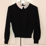 Black cropped sweater with attached collar is being swapped online for free