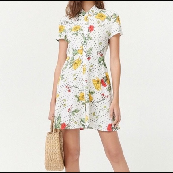 Button-up white floral dress with black dots is being swapped online for free