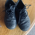 Sparkly black athletic shoes  is being swapped online for free