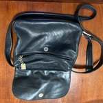 Useful black satchel purse by Tiganello is being swapped online for free