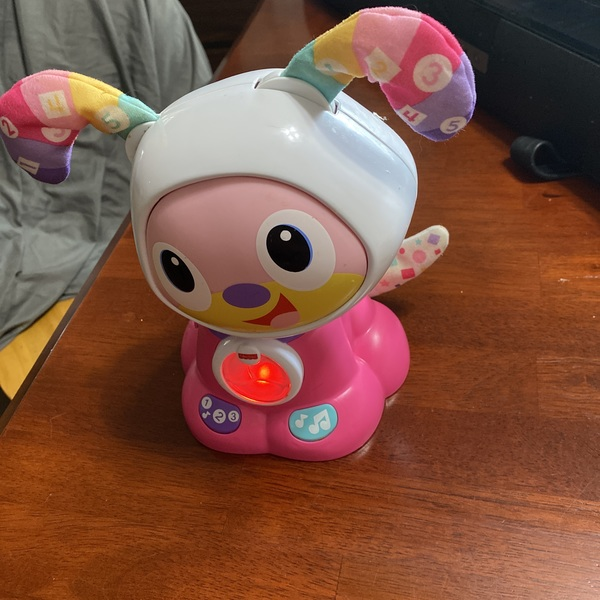 Cute pink singing puppy toy.  is being swapped online for free