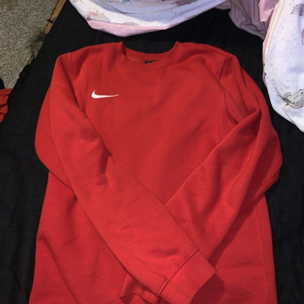 Red Nike sweatshirt  is being swapped online for free
